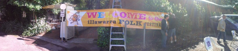 How many folkies does it take to erect a banner?