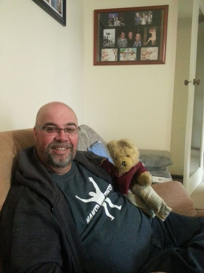 Craig Coombes at home, holding the interviewer's teddy bear, for some reason that I'm sure made perfect sense at the time...